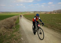 VC Walcot rider Claire Cottrell speeds through Flanders countryside on a gravel track