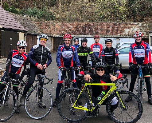 Cyclists from the Swindon Road Club meet up at the Old Stables cafe in Castle Combe, Wiltshire UK