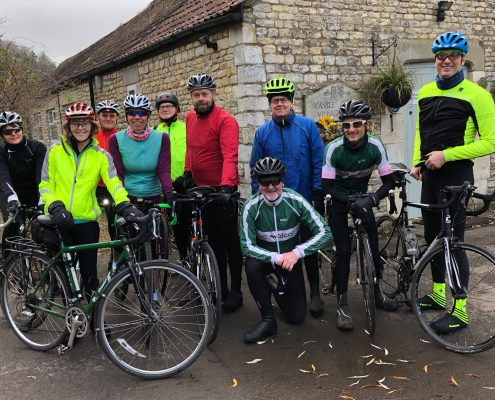 Cyclists from the Velo Club Walcot from Bath, UK, meet up for coffee at Castle Combe in Wiltshire